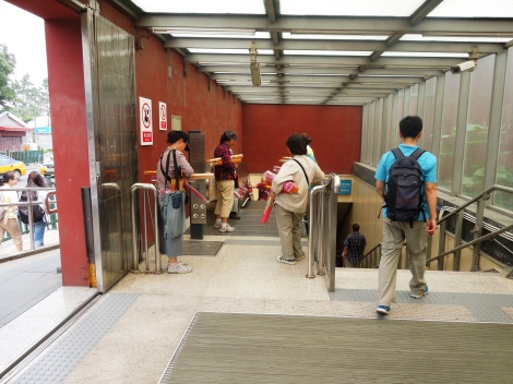 Incense sellers ready and waiting at the top of the subway escalator.