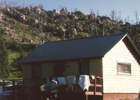 I don't have a picture of our mobile home. This was one of the other cabins set against 'Tick Mountain.'