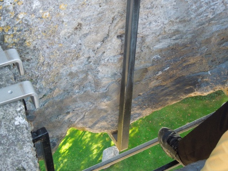 The Blarney Stone is at the bottom tip. You have to bend over backwards to kiss it.