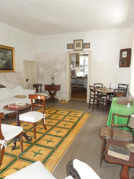Parlor/game room with flooring that was a precursor to linoleum