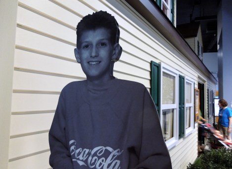 Ryan White in front of the replica of his house