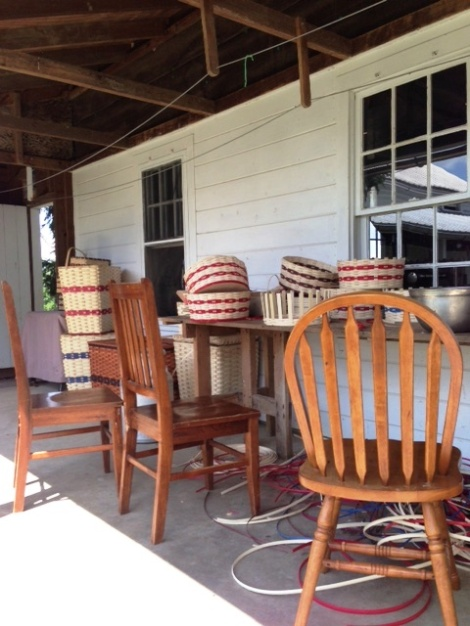 Amish-basket-weaving-on-the-porch-in-Holmes-County-Ohio