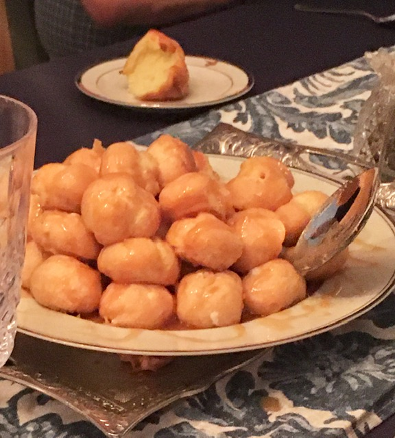 croquembouche or croque-en-bouche is a French dessert pastry puff caramel